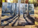 painting of trees on easel by Linda Macaulay